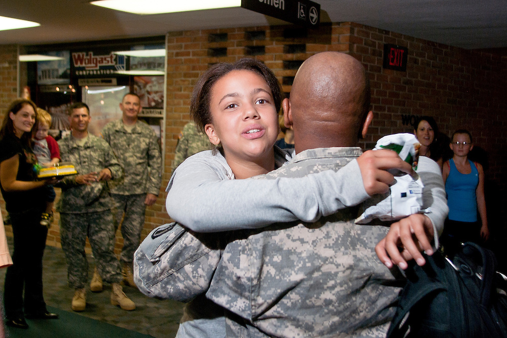 Lathan Goumas | The Bay City Times..Cassandra Rammidi, 12, of Midland, MI., hugs her father, First Lieutenant Godfrey Rammidi, upon his arrival from a tour in Kuwait at MBS International Airport in Freeland, MI., on Friday August 26, 2011.
