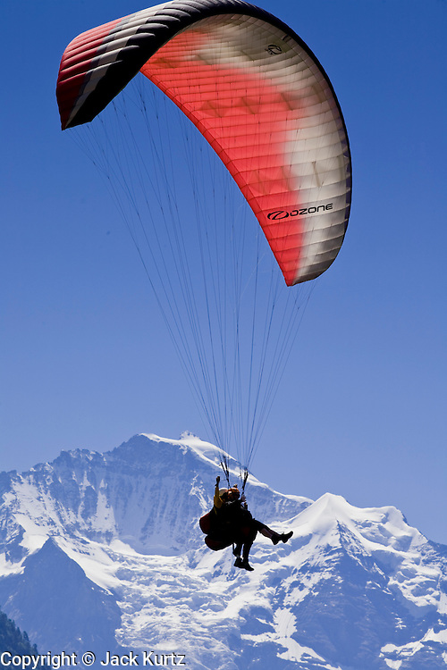 01 AUGUST 2007 -- INTERLAKEN, BERN, SWITZERLAND: Parasailers fly near the Jungfrau mountain in Interlaken. Interlaken, in the canton of Bern, is the heart of the Bernese Oberland and the center of the region's tourism industry.  Photo by Jack Kurtz