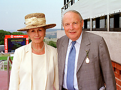 The DUKE & DUCHESS OF RICHMOND & GORDON at a race meeting in West Sussex on 30th July 1999.MUP 27