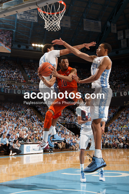 CHAPEL HILL, NC - FEBRUARY 02: Marquis Rankin #10 of the Virginia Tech Hokies passes the ball around James Michael McAdoo #43 and Brice Johnson #11 of the North Carolina Tar Heels on February 02, 2013 at the Dean E. Smith Center in Chapel Hill, North Carolina. North Carolina won 60-72 in overtime. (Photo by Peyton Williams/UNC/Getty Images) *** Local Caption *** James Michael McAdoo;Brice Johnson;Marquis Rankin
