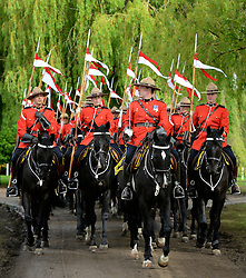 © Licensed to London News Pictures. 11/05/2012. Windsor, UK The Royal Canadian Mounted Police, who are at the show for the Jubilee Pagent, exercise their horses along the River Thames. The Royal Windsor Horse Show in Windsor, England on May 11 2012. Photo credit : Stephen Simpson/LNP