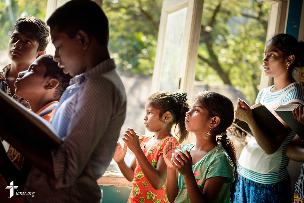 Worshippers sing during service on the Eila rubber plantation in the Sabaragamuwa Province of Sri Lanka on Sunday, Jan. 21, 2018.  LCMS Communications/Erik M. Lunsford