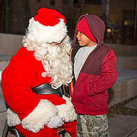 Carlos Penunuri, 7, meeting Santa at the McKinley County Courthouse Square in Gallup, Saturday Nov. 24 before the tree lighting ceremony.