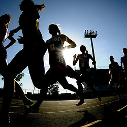 Girls are silhouetted during the 3200 meter race during the CIF-SS track and field championships at Cerritos College in Norwalk, Calif., on Saturday, May 21, 2011. (SGVN Staff Photos Keith Birmingham/SPORTS)