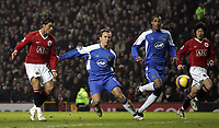 Photo: Paul Thomas.<br /> Manchester United v Wigan Athletic. The Barclays Premiership. 26/12/2006.<br /> <br /> Cristiano Ronaldo scores (L) his 2nd goal for Man Utd after he follows up his penalty miss.