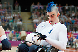 © London News Pictures. 05/09/2012. David Anthony scores a try during the wheelchair rugby match against USA. The opening game of the wheelchair rugby competition started today between ParalympicsGB and world champions USA at the Paralympic Games in Stratford, London, UK. Team USA won the match 56 - 44. Photo credit should read Manu Palomeque/LNP