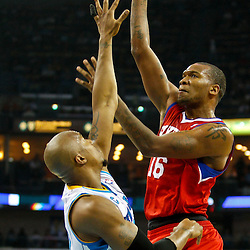 January 3, 2011; New Orleans, LA, USA; Philadelphia 76ers center Marreese Speights (16) shoots over New Orleans Hornets power forward David West (30) during the first quarter at the New Orleans Arena.   Mandatory Credit: Derick E. Hingle