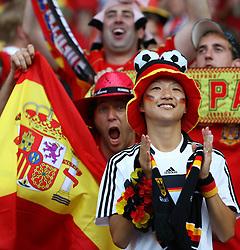 A Germany fan amongst the Spain fans