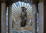 Statue of the Virgin and child on the altar, in the Basilique Notre-Dame-de-l'Immaculee-Conception or Basilica of Notre-Dame de Boulogne, a Roman Catholic cathedral built 1827-63 in Neoclassical style by Benoit-Agathon Haffreingue, in Boulogne, Pas de Calais, France. The sculpture depicts the local legend of an unmanned boat carrying a statue of the Virgin appearing in the Boulogne estuary in the 7th century, which led to several miracles being performed in the church. The cathedral is listed as a national monument. Picture by Manuel Cohen