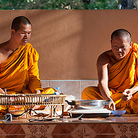 Monks sitting in Wat Thai Charoen Phu Koi.