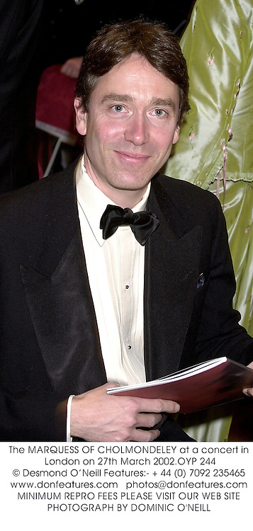 The MARQUESS OF CHOLMONDELEY at a concert in London on 27th March 2002.OYP 244