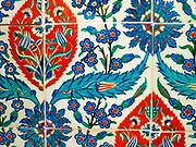 Tiles with repeat pattern.  Turkey, probably Iznik, circa 1580.  Tiles with this design are associated with the shrine of Eyup, which stands just outside the walls of Istanbul.  Each group of four tiles makes up the complete pattern.