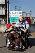 Kawasaki, November 21 2014 - Japanese artist Tatsumi ORIMOTO, 69, having a walk outside with his 97-year-old mother.