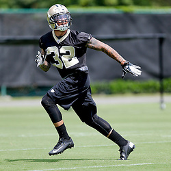 May 23, 2013; New Orleans, LA, USA; New Orleans Saints rookie safety Kenny Vaccaro (32) runs a drill during organized team activities at the Saints training facility. Mandatory Credit: Derick E. Hingle-USA TODAY Sports1
