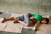 Sept. 23, 2009 -- BANGKOK, THAILAND: Homeless teenagers sleep in a pedestrian tunnel at the foot of Memorial Bridge in Bangkok. The homeless camp has been there for about 20 years. Most of the people who live there are children and teenagers ages 10 - 20. Photo by Jack Kurtz / ZUMA Press