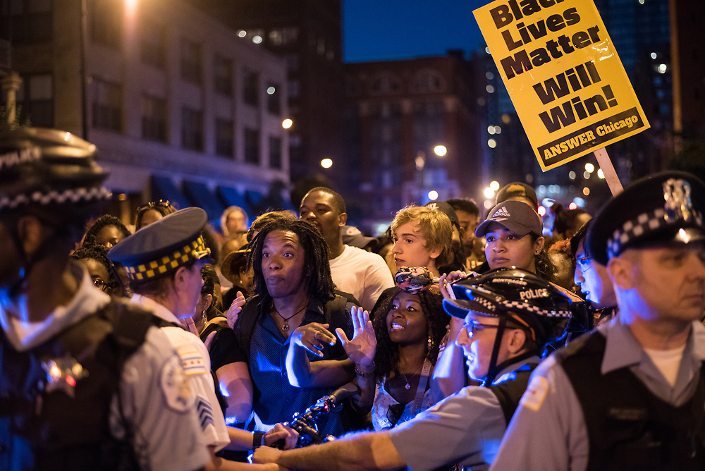 Chicago Police officers line up on Clark Street preventing protesters from continuing a march against ongoing police violence in Chicago on July 9, 2016. Following the fatal shootings of Philando Castile in Minnesota and Alton Sterling in Louisiana by police, multiple Black Lives Matter demonstrations took place across the country in July 2016.