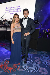 RACHEL STEVENS and MARK WRIGHT at The Butterfly Ball in aid of Caudwell Children held at the Grosvenor House, Park Lane, London on 25th June 2015