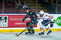 KELOWNA, CANADA - SEPTEMBER 22: Jermaine Loewen #32 of the Kamloops Blazers checks Kaedan Korczak #6 of the Kelowna Rockets on September 22, 2018 at Prospera Place in Kelowna, British Columbia, Canada.  (Photo by Marissa Baecker/Shoot the Breeze)  *** Local Caption ***