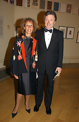 LORD & LADY HOLLICK at The Royal Academy dinner before the official opening of the Summer Exhibition held at the Royal Academy of Art, Burlington House, Piccadilly, London W1 on 6th June 2006.<br />