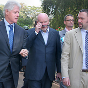 July 14, 2006 - President Clinton, with Sir Tom Hunter (right), a Scottish philanthropist who launched the Clinton Hunter Development Initiative, and an aid arrive at the presidential palace in Malawi to sign an agreement to launch the Clinton Hunter Development Initiative. Photo by Evelyn Hockstein