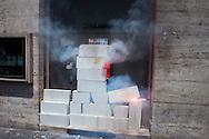 Roma 22 Giugno 2012.Manifestazione  dei sindacati di base contro le politiche economiche e sociali del Governo Monti..I manifestanti murano un bancomat della Deutsche Bank