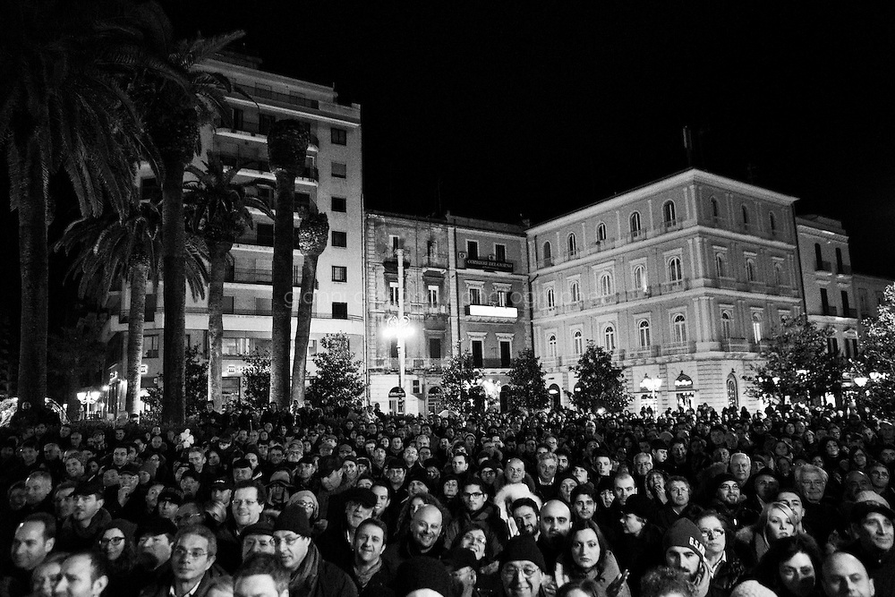 Taranto, Italy - 19 January 2013:  Comic Beppe Grillo, leader of the 5 Stars Movement in Taranto, Italy, on January 19th 2013.ROME, ITALY - 19 JANUARY 2013: Beppe Grillo, a comedian and leader of the 5 Stars Movement (M5S, Movimento 5 Stelle) rallies in Taranto, Apulia, on January 19 2013. Grillo, whom presents itself as a &quot;non-politician&quot;, and the 5 Stars Movement as &quot;not a party&quot;. Grillo has been running a mostly internet-based political campaign through the party's blog and the local groups that have emerged from it. The movement has a strong anti-politics agenda: &quot;All political parties are crooked and they all need to go&quot;, Grillo says.<br /> <br /> <br /> A general election to determine the 630 members of the Chamber of Deputies and the 315 elective members of the Senate, the two houses of the Italian parliament, will take place on 24&ndash;25 February 2013. The main candidates running for Prime Minister are Pierluigi Bersani (leader of the centre-left coalition &quot;Italy. Common Good&quot;), former PM Mario Monti (leader of the centrist coalition &quot;With Monti for Italy&quot;) and former PM Silvio Berlusconi (leader of the centre-right coalition).<br /> <br /> ###<br /> <br /> ROMA, ITALIA - 24 GENNAIO 2013: <br /> <br /> a Roma, il 24 gennaio 2013.<br /> <br /> Le elezioni politiche italiane del 2013 per il rinnovo dei due rami del Parlamento italiano &ndash; la Camera dei deputati e il Senato della Repubblica &ndash; si terranno domenica 24 e luned&igrave; 25 febbraio 2013 a seguito dello scioglimento anticipato delle Camere avvenuto il 22 dicembre 2012, quattro mesi prima della conclusione naturale della XVI Legislatura. I principali candidate per la Presidenza del Consiglio sono Pierluigi Bersani (leader della coalizione di centro-sinistra &quot;Italia. Bene Comune&quot;), il premier uscente Mario Monti (leader della coalizione di centro &quot;Con Monti per l'Italia&quot;) e l'ex-premier Silvio Berlusconi (leader della coalizione di centro-destra).