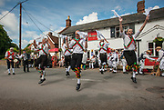 Thaxted Morris Weekend 3-4 June 2017<br /> A meeting of member clubs of the Morris Ring celebrating the 90th anniversary of the founding of the Thaxted Morris Dancing side or team in Thaxted, North West Essex, England UK. <br /> Colchester side dance at The Crown pub at Little Walden Essex.<br /> Hundred of Morris dancers from the UK and this year the Silkeborg side from Denmark spend most of Saturday dance outside pubs in nearby villages where much beer is consumed. In the late afternoon all the sides congregate in Thaxted where massed dancing is perfomed along Town Street. As darkness falls across Thaxted the spell binding Abbots Bromley Horn Dance is performed to the sound of a solo violin in the dark.
