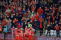 CARDIFF, WALES - Friday, September 6, 2019: Wales supporters celebrate the second goal scored by captain Gareth Bale during the UEFA Euro 2020 Qualifying Group E match between Wales and Azerbaijan at the Cardiff City Stadium. (Pic by Paul Greenwood/Propaganda)