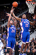 Kansas guard Brandon Rush (25) and teammate Sasha Kaun (24) reach for a defensive rebound in the second half against Kansas State at Bramlage Coliseum in Manhattan, Kansas, February 19, 2007.  Kansas beat K-State 71-62.
