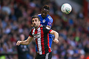 Sheffield United defender Danny Lafferty (24) and Leicester City forward Ahmed Musa (13) challenge for the header  during the EFL Cup match between Sheffield Utd and Leicester City at Bramall Lane, Sheffield, England on 22 August 2017. Photo by Simon Davies.