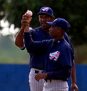 024222.SP.0114.angels16.kc--San Pedro de Macoris, Dominican Republic--Before the game between the Angels Baseball Academy Team and the Boston Red Sox Academy players get one on one instructions from coaches. The baseball academies are run by several MLB teams and they provide an all around learning experience for boys once they reach sixteen.