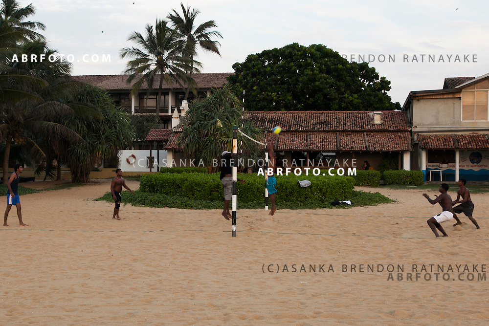 A group of Men play beach Volleyball along the shore of Negombo Beach.Negombo is a major city in Sri Lanka, located on the west coast of the island and at the mouth of the Negombo Lagoon