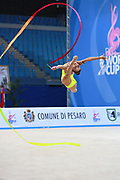 Vladinova Neviana during qualifying at ribbon in Pesaro World Cup 02 April 2016. Neviana is a gymnast from Bulgaria. She is born in Pleven in 1994. Her dream is to win a medal at the 2020 Olympic Games in Tokyo.