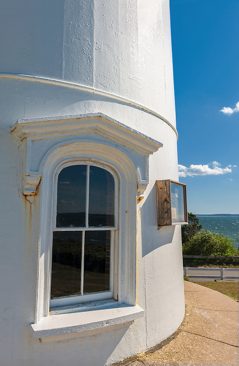 Window detail of Nobska Point Light Lighthouse, overlooking Vineyard Sound in the village of Woods Hole, town of  Falmouth, on Cape Cod Massachusetts, USA . The lighthouse is a white cast-iron tower built in 1876.