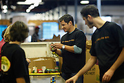 CINCINNATI, OH - OCTOBER 5:  Nick Lachey checks dates on canned food items while working with volunteers during the kickoff to The Everybody Wins Tour at Freestore Foodbank on October 5, 2009 in Cincinnati, Ohio. (Photo by Joe Robbins/WireImage for Foodbank)