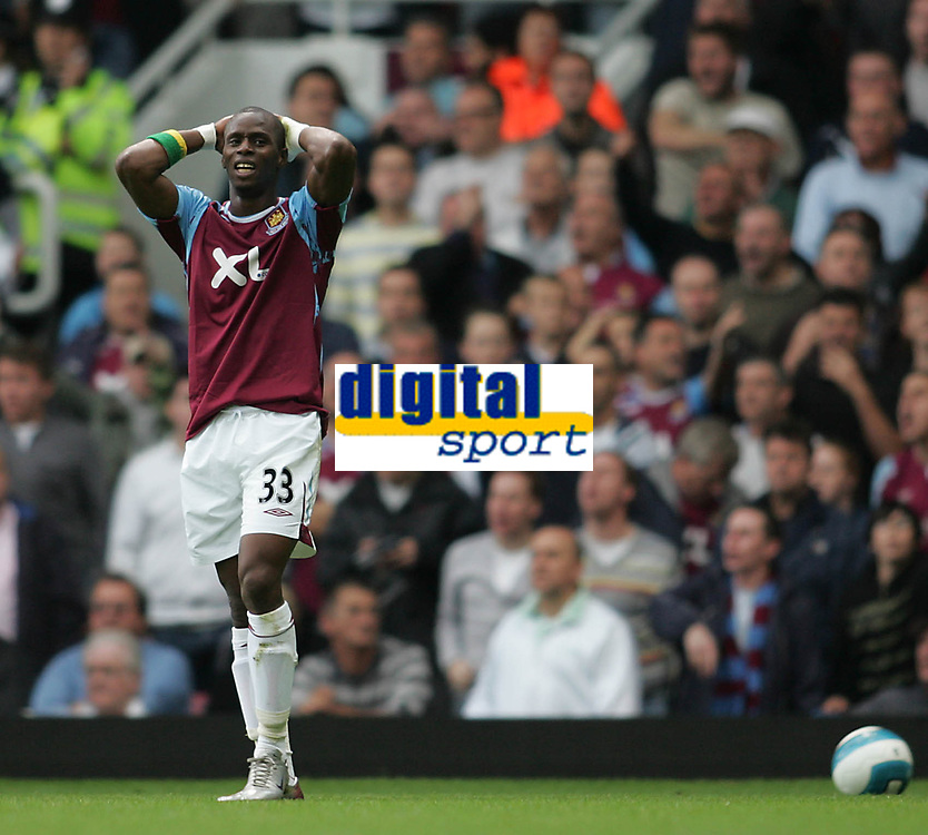 Photo: Lee Earle.<br /> West Ham United v Arsenal. The FA Barclays Premiership. 29/09/2007. West Ham's Henri Camara looks dejected after going close on goal.
