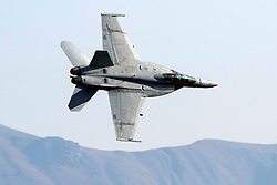 United States Navy Boeing F/A-18F Super Hornet (NE 112) from the VFA-2 Bounty Hunters squadron, Naval Air Station Lemoore, flies low level on the Jedi Transition through Star Wars Canyon / Rainbow Canyon, Death Valley National Park, Panamint Springs, California, United States of America