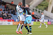 Huddersfield Town defender Joel Lynch (33)  and Sheffield Wednesday forward Gary Hooper (14) get to grips during the Sky Bet Championship match between Huddersfield Town and Sheffield Wednesday at the John Smiths Stadium, Huddersfield, England on 2 April 2016. Photo by Simon Davies.