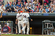 Trevor Plouffe #24 of the Minnesota Twins is congratulated by teammate Clete Thomas #11 after scoring against the Detroit Tigers on June 15, 2013 at Target Field in Minneapolis, Minnesota.  The Twins defeated the Tigers 6 to 3.  Photo: Ben Krause