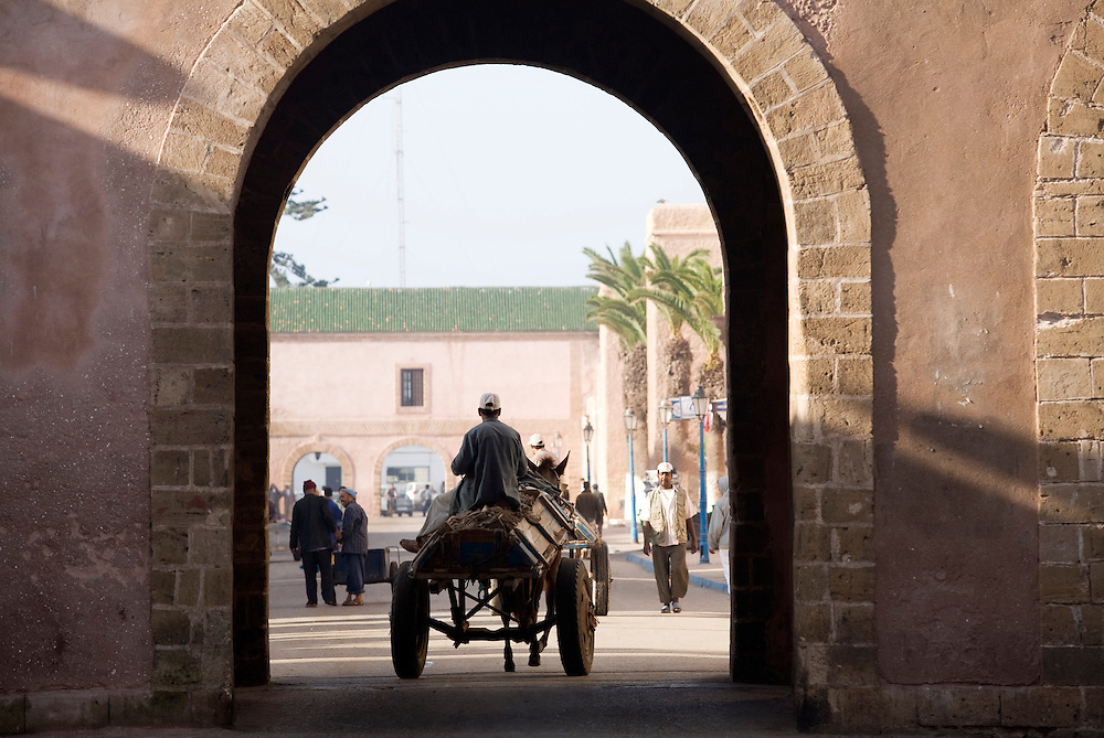 A horse and cart pass through tha gate of the fortified town of Essaouira, a fishing town on the Moroccan seaboard.