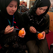 Taloqan Midwife training school<br /> <br /> Saliha Jan and  Maryam,  - practising injections on a satsuma (dermarmal and intramuscular )
