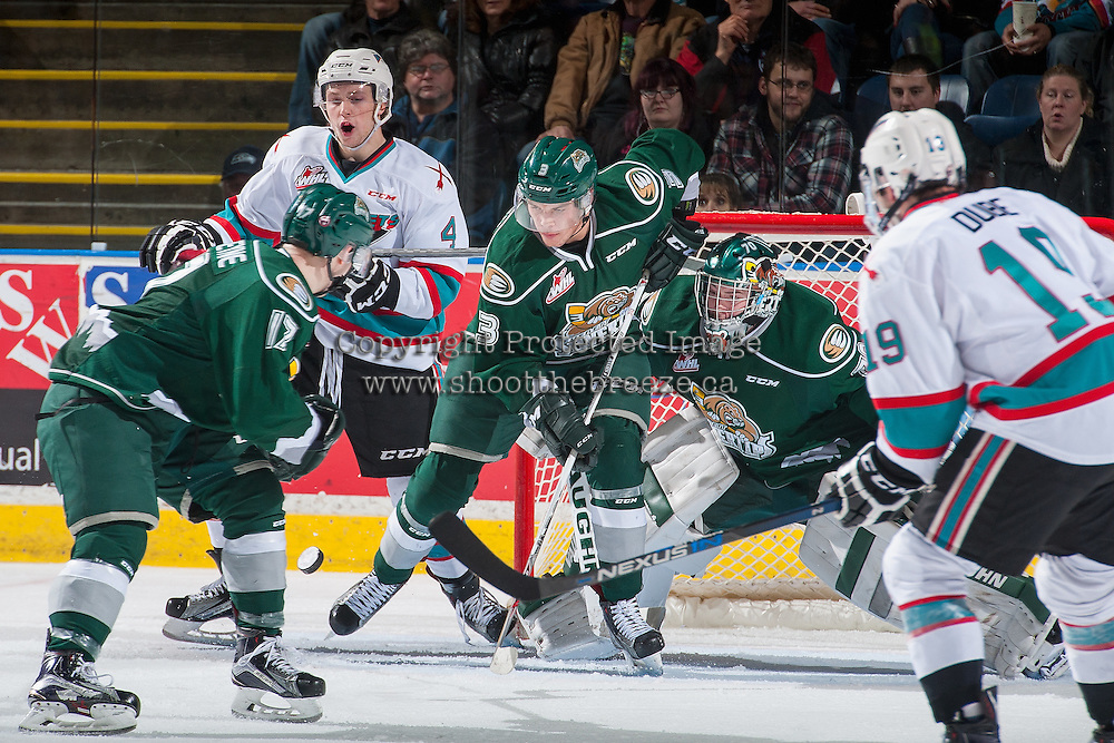 KELOWNA, CANADA - DECEMBER 30: Gordie Ballhorn #4 of Kelowna Rockets attempts to put the puck past Noah Juulsen #3 and Carter Hart #70 of Everett Silvertips on December 30, 2015 at Prospera Place in Kelowna, British Columbia, Canada.  (Photo by Marissa Baecker/Shoot the Breeze)  *** Local Caption *** Gordie Ballhorn; Carter Hart; Noah Juulsen;
