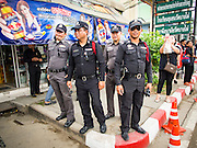 19 OCTOBER 2014 - BANG BUA THONG, NONTHABURI, THAILAND:  Thai police on duty at Apiwan Wiriyachai's cremation at Wat Bang Phai in Bang Bua Thong, a Bangkok suburb, Sunday. Hundreds of police officer were deployed to the funeral. Apiwan was a prominent Red Shirt leader. He was member of the Pheu Thai Party of former Prime Minister Yingluck Shinawatra, and a member of the Thai parliament and served as Yingluck's Deputy Prime Minister. The military government that deposed the elected government in May, 2014, charged Apiwan with Lese Majeste for allegedly insulting the Thai Monarchy. Rather than face the charges, Apiwan fled Thailand to the Philippines. He died of a lung infection in the Philippines on Oct. 6. The military government gave his family permission to bring him back to Thailand for the funeral. His cremation was the largest Red Shirt gathering since the coup. There was a very large police presence at the cremation.    PHOTO BY JACK KURTZ