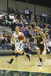 17 December 2011:  Michelle Bilek is trailed by Brandi Pudik during an NCAA womens division 3 basketball game between the St. Francis Fighting Saints and the Illinois Wesleyan Titans in Shirk Center, Bloomington IL