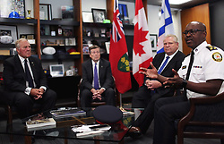 Minister of Border Security and Organized Crime Reduction Bill Blair, from left to right, Toronto mayor John Tory and Ontario Premier Doug Ford look on as police chief Mark Saunders speaks during an intergovernmental meeting in the wake of a mass shooting which happened in Toronto Sunday night, at City Hall in Toronto, ON, Canada, on Monday, July 23, 2018. Photo by Nick Kozak/CP/ABACAPRESS.COM