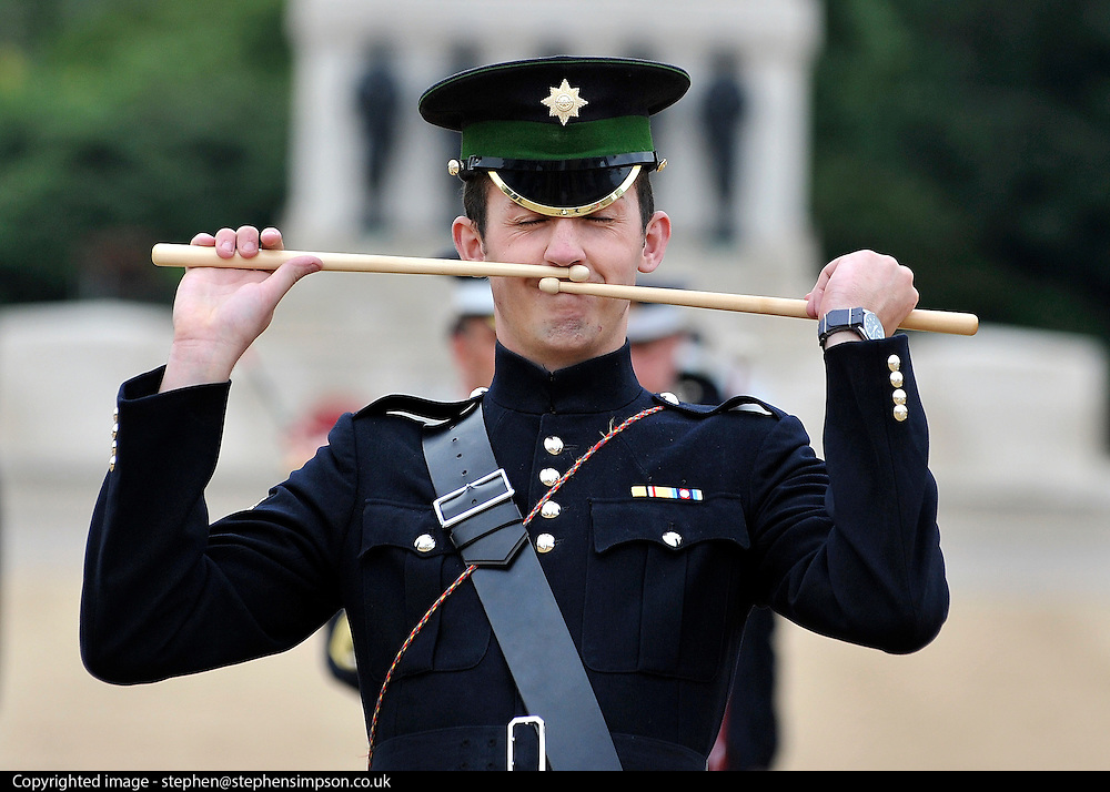 © licensed to London News Pictures. LONDON, UK.  06/06/11. A drum player from The First Batallion The Band of The Irish Guards. The United States Army Band join with the Massed Bands and Corps of Drums of the Household Division to rehearse Beat Retreat at Horse Guards Parade. The event takes place on 8th and 9th June for featuring the US band the first time. The US visit comes two weeks after the State visit to London of the US President..  Photo credit should read Stephen Simpson/LNP