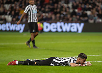 Football - 2018 / 2019 Premier League - West Ham United vs. Newcastle United<br /> <br /> Ayoze Perez (Newcastle United) lays on the ground after missing an opportunity at the London Stadium<br /> <br /> COLORSPORT/DANIEL BEARHAM