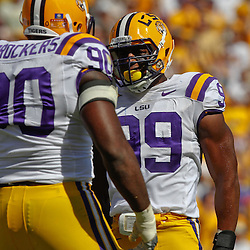 October 8, 2011; Baton Rouge, LA, USA; LSU Tigers defensive end Sam Montgomery (99) celebrates a defensive stop with teammate LSU Tigers defensive tackle Michael Brockers (90) during the first quarter against the Florida Gators at Tiger Stadium.  Mandatory Credit: Derick E. Hingle-US PRESSWIRE / © Derick E. Hingle 2011
