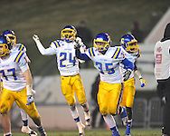 Oxford High's Thomas Allen (35) and Oxford High's Mark Pegues (24) celebrate a stop vs. Picayune in the MHSAA Class 5A championship game at Mississippi Veterans Memorial Stadium in Jackson, Miss. on Saturday, December 7, 2013. Picayune rallied to win 42-35.