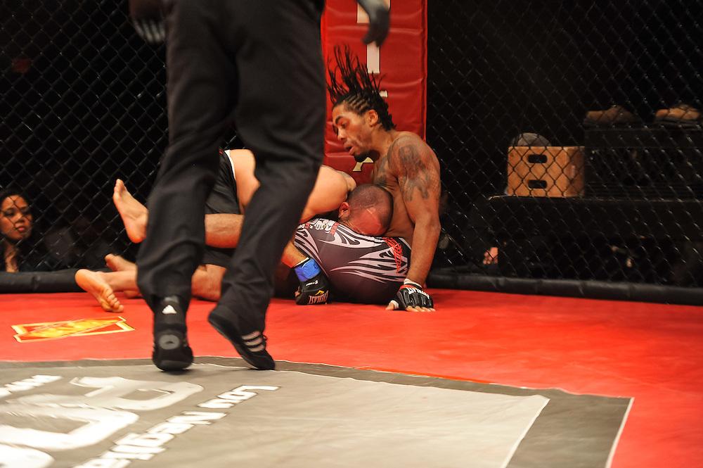 Atlantic City, New Jersey, January 24, 2014: Steven Regman(black/white shorts) Vs Jonathan Hughes(black shorts)  at Ring of Combat 47 at The Tropicana Casino